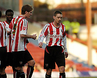 Photo: Leigh Quinnell.<br /> Brentford v Huddersfield Town. Coca Cola League 1. 21/01/2006. Ricky Newman(C) is sent off by referee Keith Stroud.