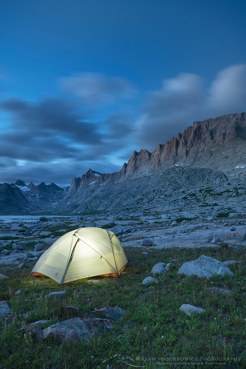 Milky Way over Glowing tent at backcountry camp in Titcomb Basin, Bridger Wilderness, Wind River Range Wyoming