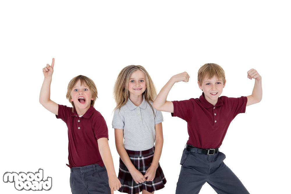 Portrait of cheerful school children over white background