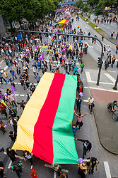 8th July, 2017. Hamburg, Germany. large demonstration march through central Hamburg protesting against G20 Summit taking place in city. This is flag of Syrian Kurdistan