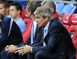 Manchester City Manager, Manuel Pellegrini  - Photo mandatory by-line: Joe Meredith/JMP - Tel: Mobile: 07966 386802 25/08/2013 - SPORT - FOOTBALL - Cardiff City Stadium - Cardiff -  Cardiff City V Manchester City - Barclays Premier League