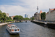 Tourist boat on the Spree, in the background the museum island and the TV tower,Berlin,Germany