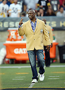 Former San Francisco 49ers and Dallas Cowboys defensive end Charles Haley waves as he is introduced as a newly enshrined member of the NFL Pro Football Hall of Fame before the Pittsburgh Steelers 2015 NFL Pro Football Hall of Fame preseason football game against the Minnesota Vikings on Sunday, Aug. 9, 2015 in Canton, Ohio. The Vikings won the game 14-3. (©Paul Anthony Spinelli)