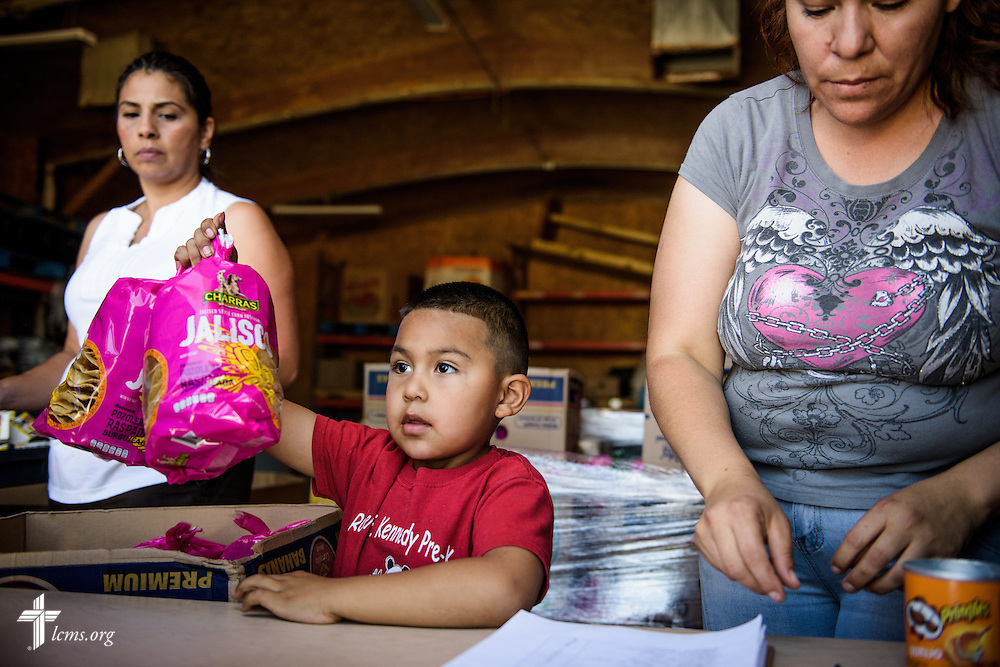 Volunteers and YLM staff hand out food during a distribution on Saturday, May 21, 2016, at Ysleta Lutheran Mission Human Care in El Paso, Texas. LCMS Communications/Erik M. Lunsford