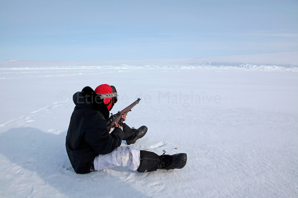 Canadian Rangers  practice shooting on icepack off Gascoyne Inlet (Devon Island, Nunavut) during Nunalivut 2012 sovereignty exercise by Canadian Forces in arctic Canada. The Rangers were issued old .303 Lee Enfield rifles for self defense and hunting. Because of growing lack of spare parts, the museum-worthy WWII era weapon will be replaced soon. Rangers are non-combat, part-time reserve auxiliariesunits that mix Inuit, local volunteers and professional military acting as eyes and ears in the most remote areas of northern Canada.