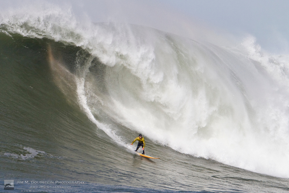 Alex Martins surfs a giant wave at the 2010 Mavericks Surf Contest held in Half Moon Bay, California on February 13, 2010