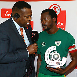 DURBAN, SOUTH AFRICA - SEPTEMBER 30: Robert Marawa with man of the match Olaleng Shaku of Baroka FC during the Absa Premiership match between Kaizer Chiefs and Baroka FC at Moses Mabhida Stadium on September 30, 2017 in Durban, South Africa. (Photo by Steve Haag/Gallo Images)