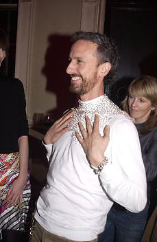 Patrick Cox trying on Erin O'Connor's necklace. De Beers launch of flagship store and new jewelry range.  New bond St. and afterwards at the In and Out Club. 21 November 2002. © Copyright Photograph by Dafydd Jones 66 Stockwell Park Rd. London SW9 0DA Tel 020 7733 0108 www.dafjones.com