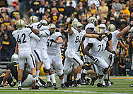 November 10 2012: Purdue Boilermakers holder Cody Webster (42), kicker Paul Griggs (37), and tight end Sterling Carter (81) celebrate the game winning 46 yard field goal after the end of the NCAA football game between the Purdue Boilermakers and the Iowa Hawkeyes at Kinnick Stadium in Iowa City, Iowa on Saturday, November 10, 2012. Purdue defeated Iowa 27-24.