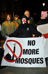 © Licensed to London News Pictures. 07/01/2014; Bristol, UK.  Members of the English Defence League protest on College Green in Bristol against the planning application to convert a former comedy club and concert venue on Bristol's Cheltenham Road into a mosque.  The EDL were confronted and outnumbered by anti-fascist and anti-racist protesters opposing the EDL and police kept the two sides apart.  07 January 2014.<br /> Photo credit: Simon Chapman/LNP