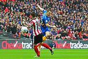 Shrewsbury Town's Carlton Morris has a shot at goal which hits the crossbar and goes over during the EFL Trophy Final match between Lincoln City and Shrewsbury Town at Wembley Stadium, London, England on 8 April 2018. Picture by John Potts.