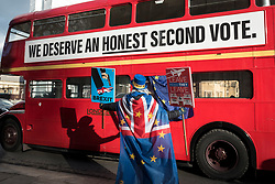 © Licensed to London News Pictures. 30/01/2019. LONDON, UK.  Steve Bray of SODEM (Stand of Defiance European Movement) holds up signs in protest against Brexit outside the Houses of Parliament on the day after MPs supported a proposal for Theresa May, Prime Minister to renegotiate her Brexit deal.  Photo credit: Stephen Chung/LNP