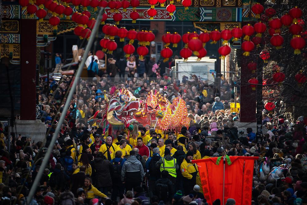© Licensed to London News Pictures . 10/02/2019 . Manchester , UK . Two dragons in the procession through China Town . People celebrate Chinese New Year in Manchester with a display of oriental culture and a procession through the city centre . Photo credit : Joel Goodman/LNP