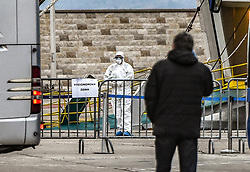 Health Ministry officials wear protective suits as the Eleftherios Venizelos passenger ship is moored at the dock of Piraeus after 119 passengers tested positive for the novel coronavirus and authorities placed the ship under quarantine, following the outbreak of coronavirus disease (COVID-19), in Piraeus, Greece, April 3, 2020.<br /> <br /> Pictured: <br /> Dimitris Lampropoulos  | EEm date