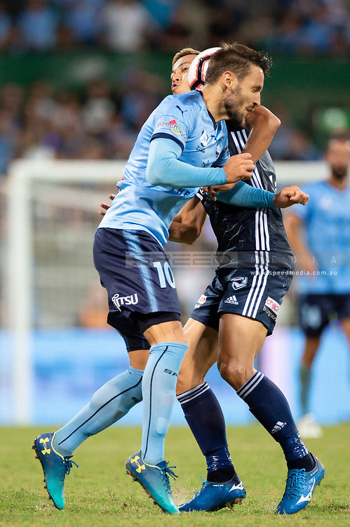 SYDNEY, AUSTRALIA - APRIL 06: Sydney FC midfielder Milos Ninkovic (10) and Melbourne Victory midfielder Keisuke Honda (4) clash at round 24 of the Hyundai A-League Soccer between Sydney FC and Melbourne Victory on April 06, 2019, at The Sydney Cricket Ground in Sydney, Australia. (Photo by Speed Media/Icon Sportswire)