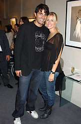STEPHEN SOLAKA and fiance NICOLE KING at a private view of fashion designer Lindka Cierach's Couture Dresses drawn by Trudy Good held at the Belgravia Gallery, 45 Albemarle Street, London on 21st September 2005.<br /><br />NON EXCLUSIVE - WORLD RIGHTS