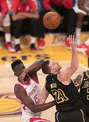 April 10, 2018 - Los Angeles, California, U.S - Travis Wear #21 of the Los Angeles Lakers battles Clint Capela #15 of the Houston Rockets for the ball during their NBA game on Tuesday April 10, 2018 at Staples Center in Los Angeles, California. Lakers lose to Rockets, 105-99. (Credit Image: © Prensa Internacional via ZUMA Wire)