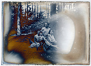 extreme deteriorated glass plate with three women in the woods France circa 1920s