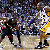 10 March 2011: Miami Heat shooting guard Dwyane Wade (3) dribbles against Los Angeles Lakers shooting guard Kobe Bryant (24) during the Miami Heat 94-88 victory over the Los Angeles Lakers at the AmericanAirlines Arena, Miami, Florida, USA.