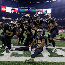 Nov 5, 2017; New Orleans, LA, USA; New Orleans Saints Justin Hardee (center) celebrates with special teams teammates posing for a photo in the endzone after a blocked punt for a touchdown against the Tampa Bay Buccaneers during the first quarter of a game at the Mercedes-Benz Superdome. Mandatory Credit: Derick E. Hingle-USA TODAY Sports