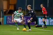 31st October 2018, Kilmac Stadium, Dundee, Scotland; Ladbrokes Premiership football, Dundee v Celtic; Jack Lambert of Dundee takes on Kieran Tierney of Celtic
