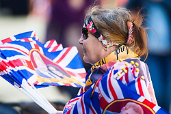 A woman sells royal wedding merchandise as excitement builds up in Windsor ahead of the royal wedding on Saturday 19th May when HRH Prince Harry weds actress Megan Markle. Windsor, May 17 2018.
