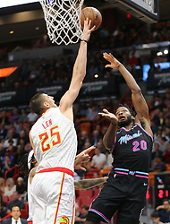 November 27, 2018 - Miami, FL, USA - Miami Heat's Justice Winslow is blocked by Atlanta Hawks' Alex Len in the first quarter on Tuesday, Nov. 27, 2018 at the AmericanAirlines Arena in Miami, Fla. (Credit Image: © Charles Trainor Jr/Miami Herald/TNS via ZUMA Wire)