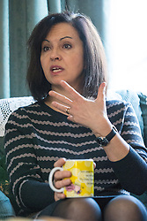 © Licensed to London News Pictures . 30/01/2014 . Manchester, UK. CAROLINE FLINT MP with tea . Shadow Secretary of State for Energy and Climate Change , Caroline Flint MP , with PPC Mike Kane in the home of pensioners Dee (82) and Ted (88) Amesbury ahead of the Wythenshawe and Sale East by-election . Photo credit : Joel Goodman/LNP