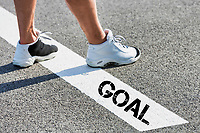 Man standing on white line with goal sign