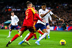 Marcus Rashford of England is challenged by Marko Vesovic of Montenegro - Rogan/JMP - 14/11/2019 - FOOTBALL - Wembley Stadium - London, England - England v Montenegro - UEFA Euro 2020 Qualifiers.