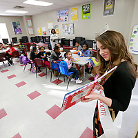 Thomas Wells   BUY AT PHOTOS.DJOURNAL.COM<br /> Miss New South Hannah Whitlock of Pontotoc spends some time reading books to a class at the Haven Acres Boys & Girls Club as part of a project she is working on to get children to read more books.