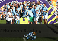 Manchester City players knock the Premier League trophy off the plinth after the Premier League match at the Etihad Stadium, Manchester.