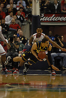 Michigan forward Jordan Morgan (52) falls to the ground while being defended by Ohio State forward David Lighty (23) in the first half of the Big Ten Tournament semifinals in Indianapolis, on March, 11, 2011, at Conseco Fieldhouse. Ohio State defeated Michigan 68-61.