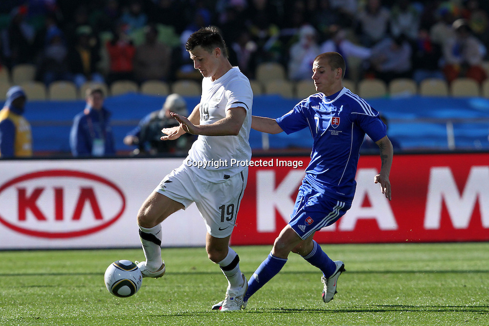Tommy Smith of New Zealand  and Vladimir Weiss of Slovakia  during the the FIFA World Cup 2010 match between New Zealand and Slovakia at The Royal Bafokeng stadium in Rustenburg, South Africa on the 15th June 2010<br /> <br /> <br /> Photo by Ron Gaunt/Sportzpics/PHOTOSPORT