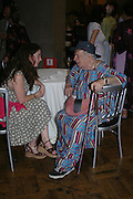 Zelda Turner and George Melly. Penguin 70 th Anniversary. Horticultural Hall. London. 20 June 2005. ONE TIME USE ONLY - DO NOT ARCHIVE  © Copyright Photograph by Dafydd Jones 66 Stockwell Park Rd. London SW9 0DA Tel 020 7733 0108 www.dafjones.com