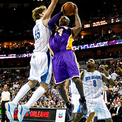 Dec 5, 2012; New Orleans, LA, USA; Los Angeles Lakers shooting guard Kobe Bryant (24) shoots over New Orleans Hornets center Robin Lopez (15) during the second quarter of a game at the New Orleans Arena.  Mandatory Credit: Derick E. Hingle-USA TODAY Sports