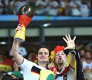 Fans of Germany point out the half time score during the 2014 FIFA World Cup match at Mineirão, Belo Horizonte<br /> Picture by Stefano Gnech/Focus Images Ltd +39 333 1641678<br /> 08/07/2014