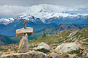 Rock cairn on the slopes of Tomyhoi Mountain Mount Baker Wilderness Washington, Mount Baker (3286 meters 10781 feet) is in the distance beauty in nature