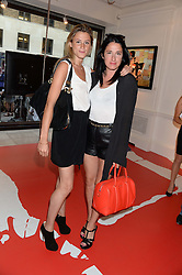 Left to right, FENELLA TAGGART and AMY MOLYNEAUX at Ronnie Wood's Raw Instinct Summer Party held at Castle Fine Art, Bruton Street, London on 9th July 2013.