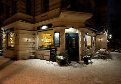 Night winter view of November cafe in bohemian Prenzlauer Berg in Berlin Germany