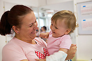 A mother and daughter enjoy a play therapy session together.