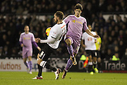 Derby County defender Richard Keogh wins the ball from Reading FC midfielder Lucas Piazon during the Sky Bet Championship match between Derby County and Reading at the iPro Stadium, Derby, England on 12 January 2016. Photo by Aaron Lupton.