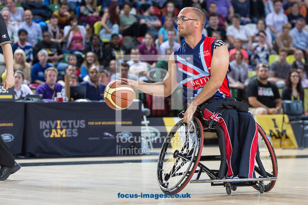 Adam Nixon, captain of Great Britain, during the Team GB v Team USA final of the Invictus Games Wheelchair  Basketball at Copper Box Arena, London<br /> Picture by Mark Chappell/Focus Images Ltd +44 77927 63340<br /> 13/09/2014