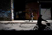 Morning commuters in Manhattan, New York.  New York has three distinct Chinatowns, all are expanding.
