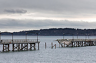 The destroyed portion of the White Rock Pier after a December 20, 2018 storm. A dock at the far end of the pier dislodged (with sailboats still attached) and ran into the pier destroying this section and damaging much of the remainder.  Photographed from the promenade at White Rock Beach in White Rock, British Columbia, Canada.
