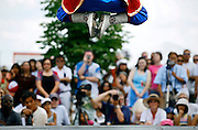 "SHOT 7/29/2007 - Zorigtbaatar Boldbaatar (top of frame), 15, of Denver leaps into the air while performing ""Mongolians on Horses"", a musical and dance piece that describes the nomadic lifestyle of the Mongolian people. Boldbaatar was performing Mongolian dances as part of a larger demonstration of the cultures represented at the 2007 Colorado Dragon Boat Festival. The sport of Dragon boat racing is over 2000 years old and features teams of 18 paddlers - nine men and nine women plus someone to steer the boat - all rowing in sync to the beat of a drum and racing to a flag 200 meters away on Sloan's Lake in Denver, Co. Founded in 2001 to celebrate Denver?s rich Asian Pacific American culture, the Colorado Dragon Boat Festival has become the region?s fastest growing and most acclaimed new festival. Festival-goers get to explore the Asian culture through demonstrations, crafts, shopping, eating, and the growing sport of dragon boat racing. .(Photo by Marc Piscotty / © 2007)"