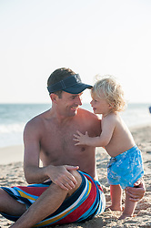 father and son enjoying time together at the beach in The Hamptons