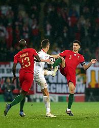 LISBON, Nov. 21, 2018  Pepe (R) of Portugal vies with Arkadiusz Milik (C) of Poland during the UEFA Nations League soccer match League A Group 3 in Guimaraes, Portugal on Nov. 20, 2018. The match ended with a 1-1 tie. (Credit Image: © Catarina Morais/Xinhua via ZUMA Wire)