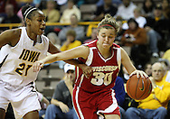 19 February 2009: Wisconsin guard Alyssa Karel (30) tries to drive around Iowa guard Kachine Alexander (21) during the second half of an NCAA women's college basketball game Thursday, February 19, 2009, at Carver-Hawkeye Arena in Iowa City, Iowa. Iowa defeated Wisconsin 72-65.