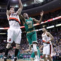 09 March 2012: Portland Trail Blazers small forward Luke Babbitt (8) grabs a rebound as Boston Celtics forward JaJuan Johnson (12) draws a foul during the Boston Celtics 104-86 victory over the Portland Trail Blazers at the TD Banknorth Garden, Boston, Massachusetts, USA.
